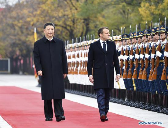 Xi holds talks with Macron, pledging for enhanced China-France ties