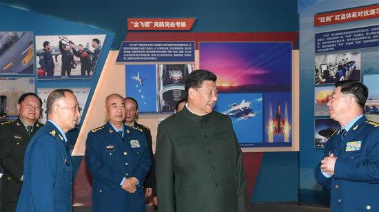 Chinese President Xi Jinping, also general secretary of the Communist Party of China (CPC) Central Committee and chairman of the Central Military Commission (CMC), visits an exhibition marking the 70th founding anniversary of the People's Liberation Army (PLA) Air Force at the China Aviation Museum in Changping District, Beijing, capital of China, Nov. 8, 2019.  (Photo/Xinhua)