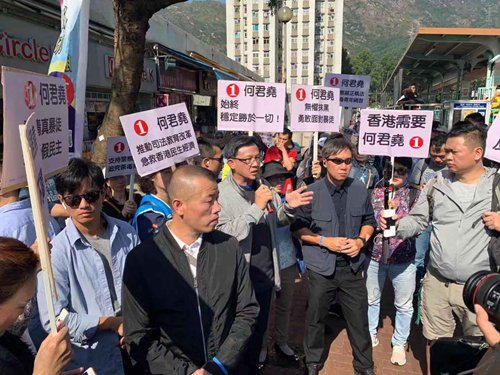 Junius Ho appears at campaign event after surviving knife attack