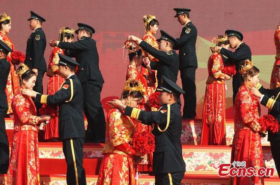PLA Rocket Force holds group wedding ceremony for soldiers