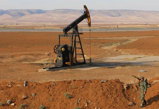 A Syrian soldier is seen in an oil field in the countryside of Qamishli, northeastern Hasakah province, Syria, on Nov. 5, 2019. (Str/Xinhua)