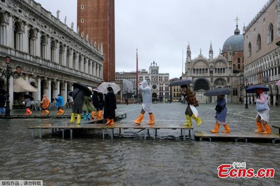Venice flooded from rising tides and rain