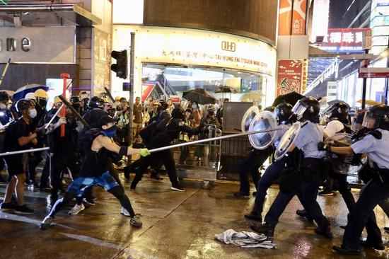 Hong Kong police say officer opening fire follows guidelines