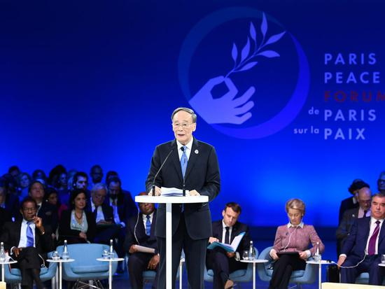 Chinese Vice President Wang Qishan addresses the opening ceremony of the second Paris Peace Forum in Paris, France, Nov. 12, 2019. (Xinhua/Shen Hong)