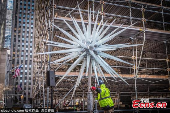 Crystal star adorns top of Rockefeller Center Christmas tree