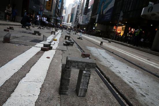 This photo taken by Xinhua shows bricks used by Hong Kong rioters as road blocks. (Xinhua)