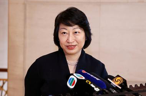 HK justice secretary attacked by protesters in London