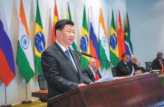 President Xi Jinping delivers a speech at the 11th BRICS Summit in Brasilia on Thursday. (Photo/Xinhua)