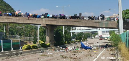 33 people injured as bus hits concrete barrier in Hong Kong