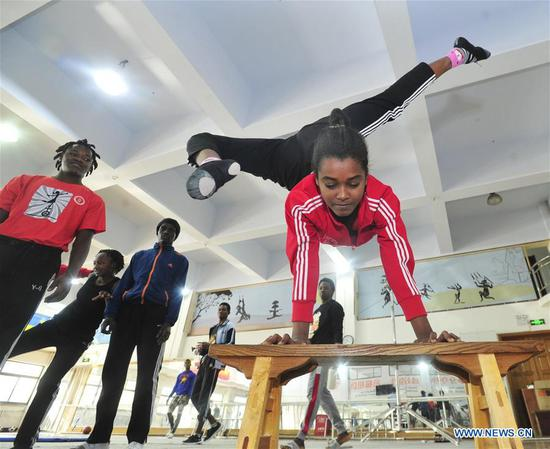 Foreigners practise acrobatics in China's Hebei