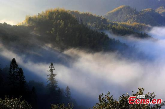 Sea of clouds covers eastern village