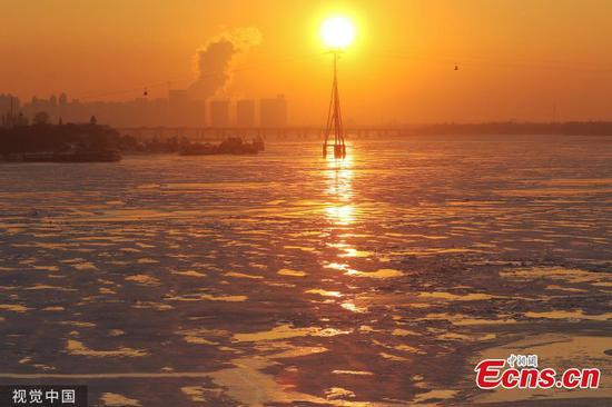 Special sunset charm on frozen Songhua River