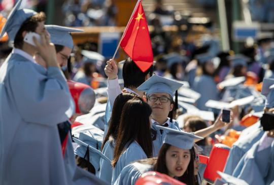 Chinese students attend a graduation ceremony at Columbia University in New York in May. (WANG YING/XINHUA)