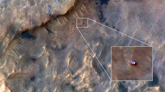 NASA's Curiosity Mars rover can be seen in this image taken from space on May 31, 2019, by the HiRISE camera aboard the Mars Reconnaissance Orbiter. In the image, Curiosity appears as a bluish speck. (Photo/NASA)