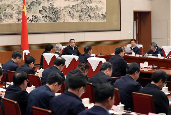 Chinese Premier Li Keqiang, also a member of the Standing Committee of the Political Bureau of the Communist Party of China (CPC) Central Committee, presides over a meeting on making the 14th Five-Year Plan (2021-2025) in Beijing, capital of China, Nov. 25, 2019. (Xinhua/Liu Weibing)