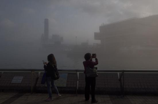 This photo shows misty, gloomy view of the landmark Victoria Harbor of Hong Kong, China. (Xinhua)