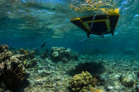 Coral reseeding using LarvalBoat. (Photo courtesy of Great Barrier Reef Foundation)
