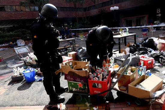 Hong Kong police, firefighters enter Hong Kong Polytechnic University for investigation on Nov. 28, 2019 in Hong Kong, China. (Xinhua)