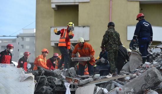 Rescuers work at the site of a collapsed building in the town of Durres, Albania. (Xinhua/Zhang Liyun)