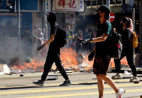 Rioters set fire to paralyze traffic in Sai Wan Ho, south China's Hong Kong, Nov. 11, 2019. (Xinhua)