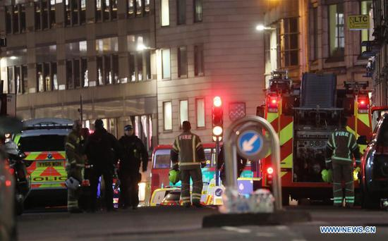 Emergency services work at the scene near London Bridge following an attack in London, Britain, on Nov. 29, 2019. One knifeman was shot dead by police officers at London Bridge on Friday. A number of people were stabbed by the man and the attack was being treated as a terror incident, police said. London Bridge was closed off. Police also said the suspect was wearing a hoax explosive device. (Photo by Isabel Infantes/Xinhua)