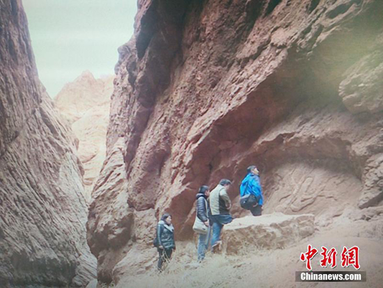 A relief of Flying Apsaras was discovered at Kuqa Grand Canyon, located in Xinjiang Uygur Autonomous Region, according to Kucha Research Institute of Xinjiang. (Photo/ China News Service)