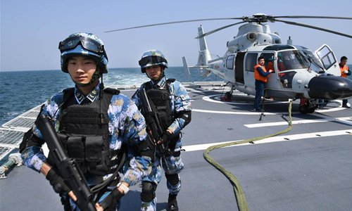 Soldiers are seen on a naval vessel during a joint naval exercise on the sea off Qingdao, east China's Shandong Province, on April 26, 2019. China conducted a joint naval exercise with Southeast Asian countries in Qingdao, with focus on jointly handling pirate threats and maritime emergency rescues.(Photo: Xinhua)