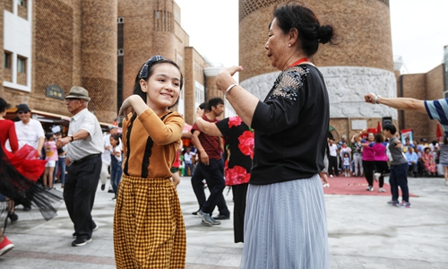 Residents in Urumqi, capital of Northwest China's Xinjiang Uyghur Autonomous Region, dance in a square. (Photo: Cui Meng/GT)
