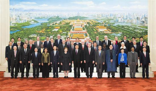 Chinese President Xi Jinping poses for a group photo with foreign delegates who were in China to attend the 2019 Imperial Springs International Forum, before meeting them at the Great Hall of the People in Beijing, capital of China, Dec. 3, 2019. (Xinhua/Huang Jingwen)