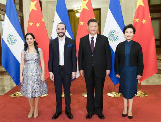 Chinese President Xi Jinping and his wife Peng Liyuan pose for photos with El Salvador's President Nayib Armando Bukele Ortez and his wife at the Great Hall of the People in Beijing, capital of China, Dec. 3, 2019. Chinese President Xi Jinping held talks with El Salvador's President Nayib Armando Bukele Ortez at the Great Hall of the People in Beijing on Tuesday. (Xinhua/Huang Jingwen)