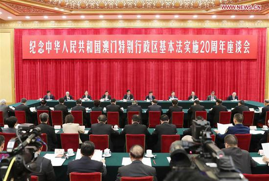 Li Zhanshu, a member of the Standing Committee of the Political Bureau of the Communist Party of China Central Committee and chairman of the Standing Committee of the National People's Congress, speaks at a symposium marking the 20th anniversary of the implementation of the Basic Law of the Macao Special Administrative Region (SAR) in Beijing, capital of China, Dec. 3, 2019. (Xinhua/Liu Weibing)