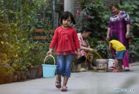 Measures carried out in poverty-stricken villages in Xinjiang to improve locals' living standards