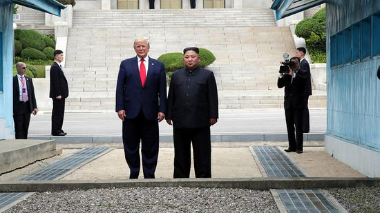 File photo: U.S. President Donald Trump (L) and the Democratic People's Republic of Korea (DPRK) top leader Kim Jong Un posed for a photo. (CGTN)