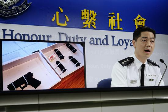 Hong Kong police on Monday show a semi-automatic pistol seized in operation carried out on Sunday. (Xinhua)