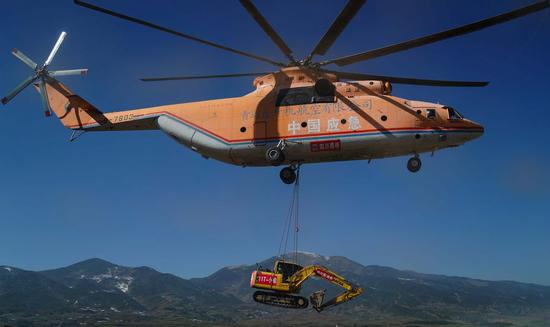 The giant comes to village: helicopter helps road construction in Sichuan