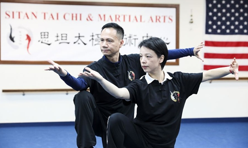 Chen Sitan (L) and his wife Lin Xu perform Tai Chi at Sitan Tai Chi and Martial Arts, a martial art school in Syosset of New York, the United States, Nov. 20, 2019. (Xinhua/Wang Ying)