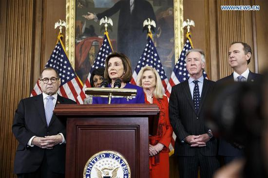 U.S. House Speaker Nancy Pelosi (C, Front) speaks at a news conference to announce articles of impeachment against U.S. President Donald Trump on Capitol Hill in Washington D.C., the United States, on Dec. 10, 2019.  (Photo/Xinhua)