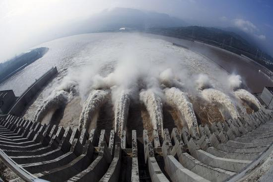 Photo taken on July 12, 2018 shows water discharging from the Three Gorges Dam, a gigantic hydropower project on the Yangtze River, in Yichang City, central China's Hubei Province. (Xinhua/Wen Zhenxiao)