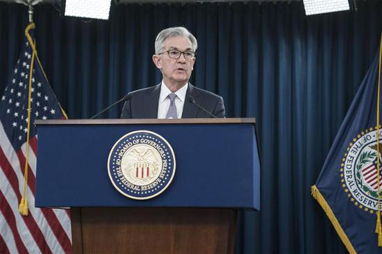 U.S. Federal Reserve Chairman Jerome Powell speaks during a press conference in Washington D.C., the United States, on Dec. 11, 2019. The U.S. Federal Reserve on Wednesday left interest rates unchanged after cutting rates at each of the last three meetings, as officials assessed the effect of rate cuts on the U.S. economy. (Photo by Sarah Silbiger/Xinhua)