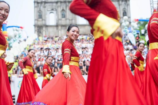 Dancers perform in front of the Ruins of St. Paul's during a parade of the International Youth Dance Festival in south China's Macao, July 20, 2019. (Xinhua/Cheong Kam Ka)