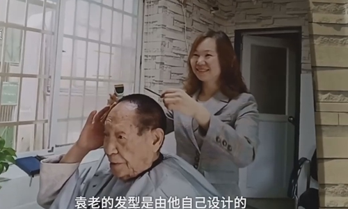 Small barbershop favored by 'father of hybrid rice' for 16 years