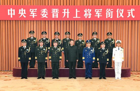 Seven Chinese military officers have been promoted to the rank of general, the highest rank for officers in active service in China, Dec. 12, 2019. (Xinhua/Li Gang)