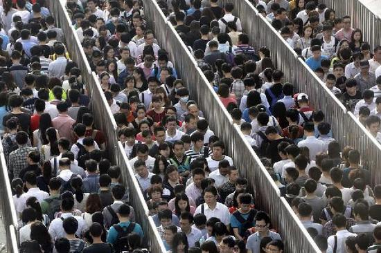 Migrant population in Beijing drops for 3rd year