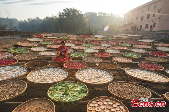 Villagers dry vegetables in the sun in Jiangxi province
