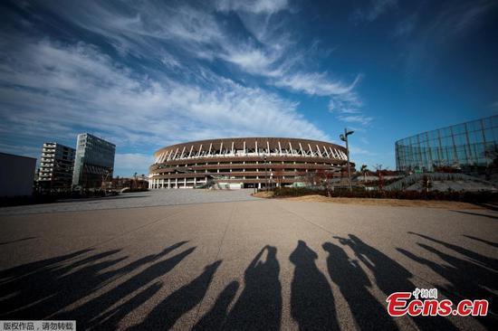 Tokyo unveils high-tech stadium, 7 months before Olympics