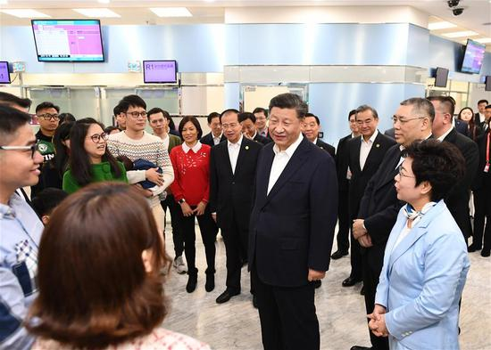President Xi visits gov't services center, school in Macao