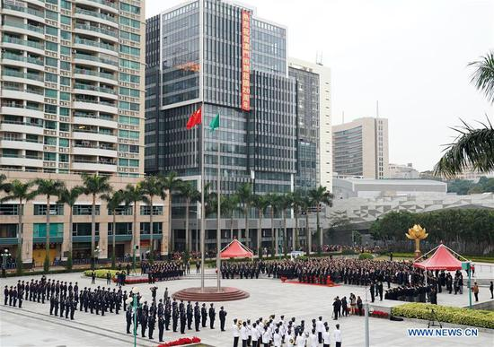 Flag-raising ceremony marking 20th anniv. of Macao's return to motherland held in Macao