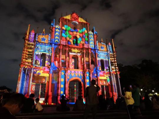 People gather at the Ruins of St. Paul's during the Macao Light Festival in the Macao Special Administrative Region on Tuesday. The festival began on Dec 1 and continues throughout the month. (Photo by Zhou Li/China Daily)
