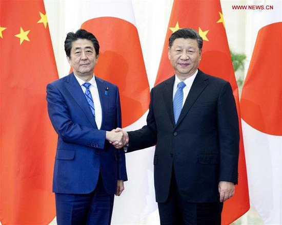 Chinese President Xi Jinping meets with Japanese Prime Minister Shinzo Abe at the Great Hall of the People in Beijing, capital of China, Dec. 23, 2019. (Xinhua/Li Xueren)