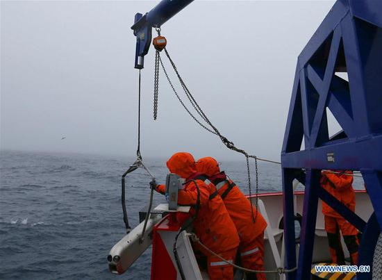 China's 36th Antarctic expedition team work on Xuelong 2